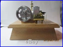 Model hit & miss engine built by retired machinist